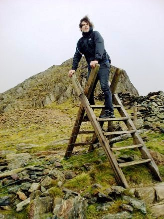 Climbing over a gate mount snowden Wales