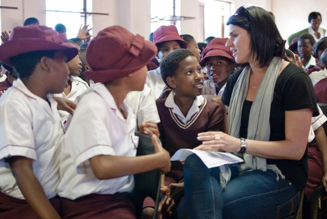 Surrounded by curious kids at a primary school in South Africa