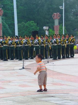 chinese boy dancing at the parade
