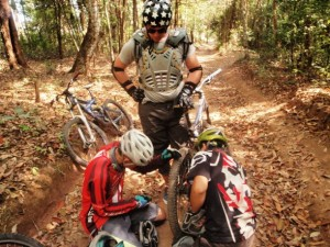 Mountain Bike guides working on bike in Chiang Mai