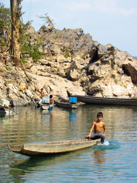 playing on boats in Laos