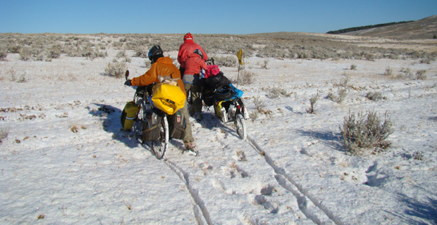 family on bikes in the snow